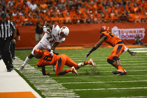 Antwan Cordy, Syracuse's starting safety, is shown here making a tackle against Louisville last year. Cordy has received praise this week from both Babers and Franklin.